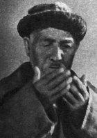 Е. УМУРЗАКОВ
